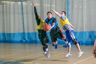 Intramural basketball action on a Tuesday night at the Student Recreation Center.  Filename: LIF-14-4111-286.jpg