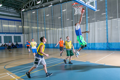 Intramural basketball action on a Tuesday night at the Student Recreation Center.  Filename: LIF-14-4111-310.jpg