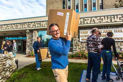 Returning students, staff and parents all pitch in to help new arrivals move into the residence halls during Rev It Up on the Fairbanks campus at the beginning of the fall 2015 semester.  Filename: LIF-15-4636-105.jpg
