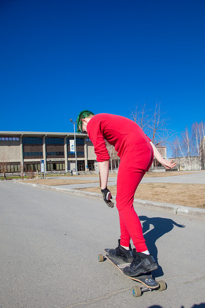 "Andrew Walsh skates around campus in his red onesie.  <div class=""ss-paypal-button"">Filename: LIF-12-3360-06.jpg</div><div class=""ss-paypal-button-end"" style=""""></div>"