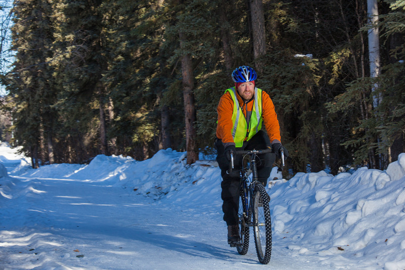 """Frank Olive, assisant coordinator of programming for UAF Outdoor Adventures, rides his bike to work on campus on a spring afternoon.  <div class=""""ss-paypal-button"""">Filename: LIF-12-3340-35.jpg</div><div class=""""ss-paypal-button-end"""" style=""""""""></div>"""