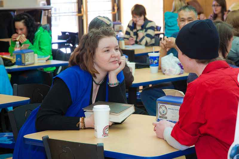 """Stephanie Sundberg, left, and Tyler McClendon perform a little """"flash theater"""" by running a scene from Theatre UAF's production of """"All in the Timing"""" during a busy time in the Wood Center food court.  <div class=""""ss-paypal-button"""">Filename: LIF-12-3325-14.jpg</div><div class=""""ss-paypal-button-end"""" style=""""""""></div>"""