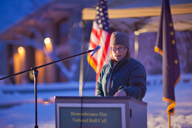 """U.S. Army veteran and current UAF student Maire Hunt takes an early 15-minute shift reading names of American service men and women killed during the wars in Iraq and Afghanistan during a Veterans' Day memorial ceremony in Constitution Park.  <div class=""""ss-paypal-button"""">Filename: LIF-11-3216-12.jpg</div><div class=""""ss-paypal-button-end"""" style=""""""""></div>"""