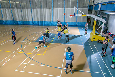 Intramural basketball action on a Tuesday night at the Student Recreation Center.  Filename: LIF-14-4111-301.jpg