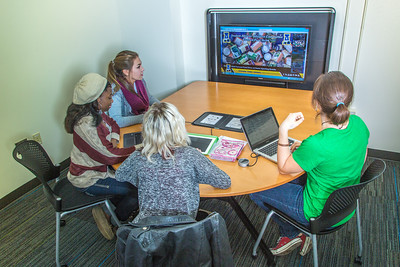 Students mingle and study in the Nook computer lounge in the Bunnell Building on the Fairbanks campus.  Filename: LIF-13-3987-65.jpg