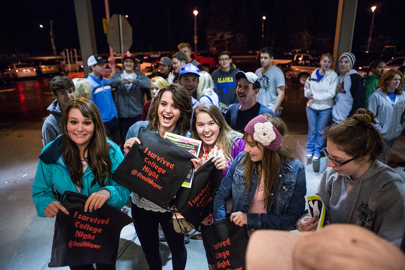 """Holding small black bags, students patiently wait in line at the store entrance during the Fred Meyer College Night shopping extravaganza.  <div class=""""ss-paypal-button"""">Filename: LIF-13-3926-6.jpg</div><div class=""""ss-paypal-button-end"""" style=""""""""></div>"""
