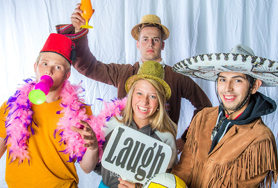 Students pose in the UAF Facebook photobooth during a back-to-school orientation party in the Wood Center.  Filename: LIF-12-3517-209.jpg