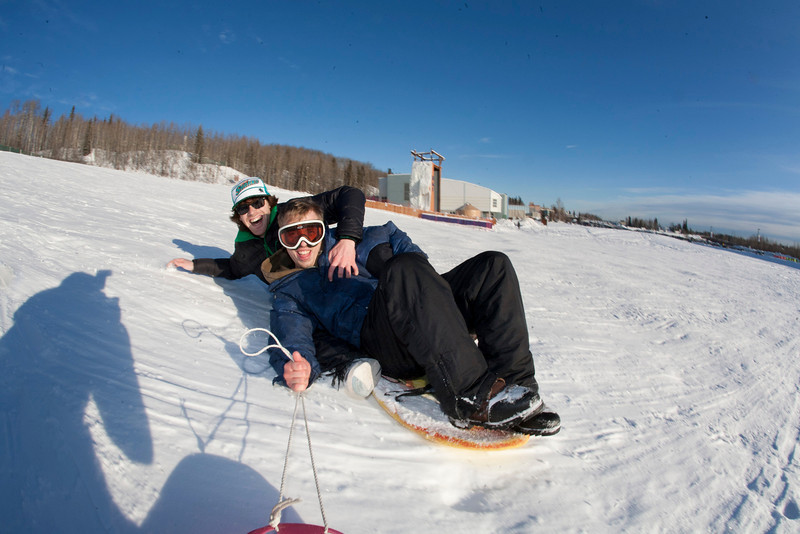 """Jimmy Donohue (back) and Bryan Johnson (front) go sledding on a sunny day in February.  <div class=""""ss-paypal-button"""">Filename: LIF-12-3289-41.jpg</div><div class=""""ss-paypal-button-end"""" style=""""""""></div>"""