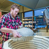 "Art major Ian Wilkinson lowers one of several turkeys into a kiln for cooking in the ceramics lab in the UAF Fine Arts complex. The birds are covered in clay and then baked in a kiln before being served up during a feast for hungry students on campus over Thanksgiving break.  <div class=""ss-paypal-button"">Filename: LIF-12-3659-104.jpg</div><div class=""ss-paypal-button-end"" style=""""></div>"