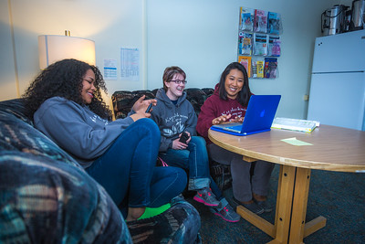 Undergraduates Kisha Lee, left, Michaela Lockes and Dyane Chung relax after class in the student lounge at UAF's Kuskokwim Campus in Bethel.  Filename: LIF-16-4859-144.jpg