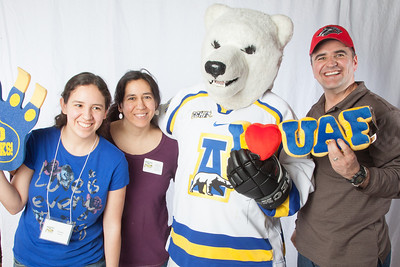 Future UAF students and family  members pose with the Nanook mascot during InsideOut.  Filename: LIF-12-3334-136.jpg