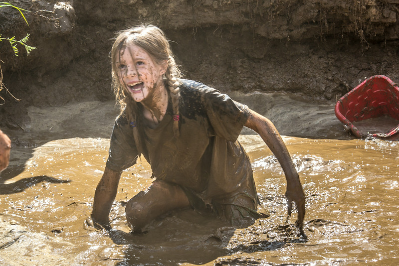"Nine-year-old Rosie Paris had a good time playing in the pit during Mud Day in the Georgeson Botanical Garden, sponsored by UAF's School of Natural Resources and Extension.  <div class=""ss-paypal-button"">Filename: LIF-14-4212-55.jpg</div><div class=""ss-paypal-button-end""></div>"