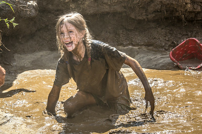 Nine-year-old Rosie Paris had a good time playing in the pit during Mud Day in the Georgeson Botanical Garden, sponsored by UAF's School of Natural Resources and Extension.  Filename: LIF-14-4212-55.jpg