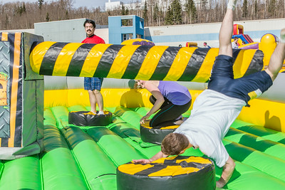 Students took turns getting knocked around on one of the many attractions brought to campus during SpringFest Field Day on April 28.  Filename: LIF-14-4168-97.jpg