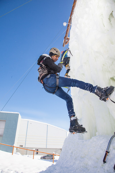 "Students take advantage of nice spring weather to try out their climbing skills on the new ice wall near the SRC.  <div class=""ss-paypal-button"">Filename: LIF-12-3321-024.jpg</div><div class=""ss-paypal-button-end"" style=""""></div>"