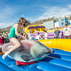 "Students took turns getting  knocked off the spinning salmon, one of the many attractions brought to campus during SpringFest Field Day on April 28.  <div class=""ss-paypal-button"">Filename: LIF-14-4168-118.jpg</div><div class=""ss-paypal-button-end""></div>"