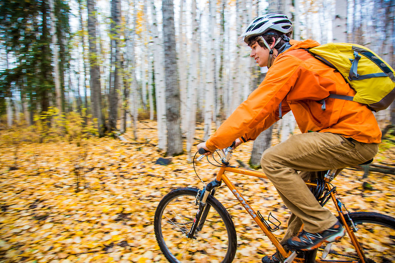"""Mechanical engineering major Adam McCombs rides his bike through the woods towards campus on a recent foggy morning.  <div class=""""ss-paypal-button"""">Filename: LIF-12-3556-140.jpg</div><div class=""""ss-paypal-button-end"""" style=""""""""></div>"""
