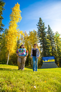 Grace Amundsen, left, and Kaylie Wiltersen stroll through the grass near the west entrance to campus on a nice fall afternoon.  Filename: LIF-12-3544-016.jpg