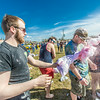 """Pillows filled with fluff and colored dye were used during a fun pillow fight as one of the attractions at UAF's SpringFest Field Day April 28.  <div class=""""ss-paypal-button"""">Filename: LIF-14-4168-278.jpg</div><div class=""""ss-paypal-button-end""""></div>"""