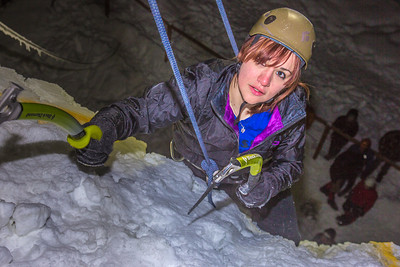 A climber approaches the top of the tower during the ice climbing competition, offered as part of the 2014 UAF Winter Carnival.  Filename: LIF-14-4084-138.jpg