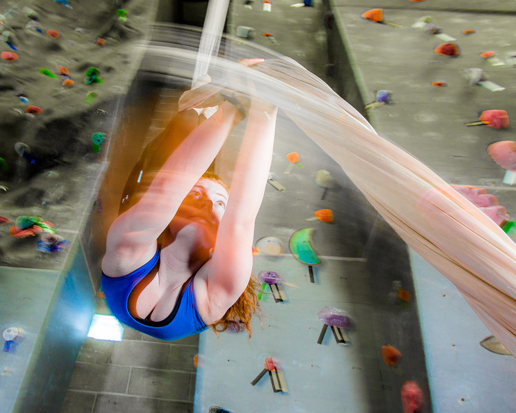 "Miriam Brooks practices her silk climbing skills on the climbing wall in the SRC.  <div class=""ss-paypal-button"">Filename: LIF-13-3819-80.jpg</div><div class=""ss-paypal-button-end"" style=""""></div>"