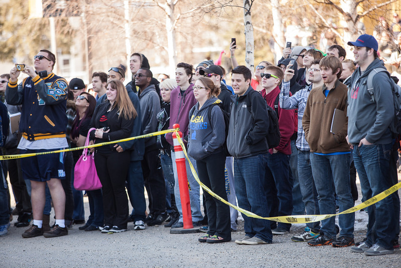 """Students congregate on the base of the Gruening Building to watch the annual Spring Fest watermelon drop.  <div class=""""ss-paypal-button"""">Filename: LIF-13-3799-131.jpg</div><div class=""""ss-paypal-button-end"""" style=""""""""></div>"""
