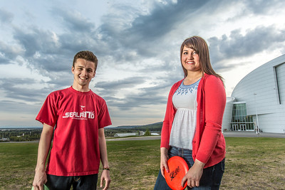Friends Aaron Druyvestein and Serena McCormick enjoy a round of disc golf on the campus course near the University of Alaska Museum of the North.  Filename: LIF-14-4191-70.jpg