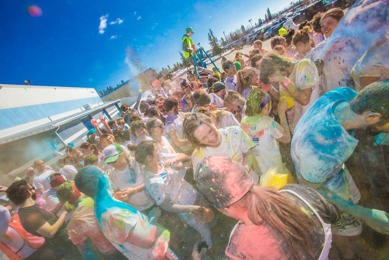 """Students enjoy getting doused with colored dye before participating in a 5-kilometer run during SpringFest on the Fairbanks campus.  <div class=""""ss-paypal-button"""">Filename: LIF-13-3805-75.jpg</div><div class=""""ss-paypal-button-end"""" style=""""""""></div>"""