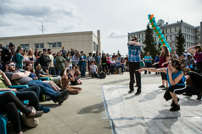 "Students dance on a makeshift dancefloor on the Wood Center deck during Spring Fest.  <div class=""ss-paypal-button"">Filename: LIF-14-4161-26.jpg</div><div class=""ss-paypal-button-end""></div>"