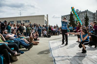 Students dance on a makeshift dancefloor on the Wood Center deck during Spring Fest.  Filename: LIF-14-4161-26.jpg