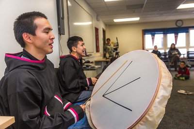Justin Bill, left, and Chase Alexie beat the drums for the KuC Yuraq Dance Group as they practice in the school's conference room on March 30, 2016 in preparation for their upcoming appearance at the Cama-i Dance Festival in Bethel.  Filename: LIF-16-4859-427.jpg
