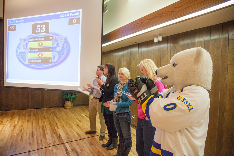 """University admissions and registrar staff members team up to compete during a friendly match of Family Feud during UAF's InsideOut event in the Wood Center ballroom.  <div class=""""ss-paypal-button"""">Filename: LIF-12-3334-090.jpg</div><div class=""""ss-paypal-button-end"""" style=""""""""></div>"""