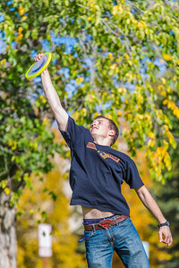 Engineering major Philip White takes time between classes to play with a frisbee on a beautiful September afternoon on the Fairbanks campus.  Filename: LIF-13-3934-57.jpg