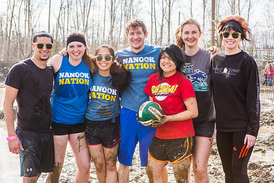 Particpants of the 2016 SpringFest mud volleyball tournament pause for a portrait in between games.  Filename: LIF-16-4879-317.jpg