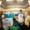 "Orientation leaders help unload new students' personal belongings from vehicles during Move-In Day Sunday, August 26, 2012 at the Moore, Bartlett, and Skarland dormitory complex front parking lot.  <div class=""ss-paypal-button"">Filename: LIF-12-3511-38.jpg</div><div class=""ss-paypal-button-end"" style=""""></div>"