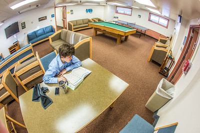 An undergraduate studies for a final in the basement lounge in Lathrop Hall on the Fairbanks campus.  Filename: LIF-13-3737-42.jpg