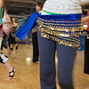 "The students of the middle eastern dance class learn how to shimmy in their beaded skirts.  <div class=""ss-paypal-button"">Filename: LIF-11-3194-127.jpg</div><div class=""ss-paypal-button-end"" style=""""></div>"