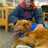 "Freshman biology major Ryan Weber takes advantage of some quality time with with a new friend on Dogs in the Library day. The event is offered during finals week to provide students with a bit of stress relief.  <div class=""ss-paypal-button"">Filename: LIF-13-4023-21.jpg</div><div class=""ss-paypal-button-end"" style=""""></div>"
