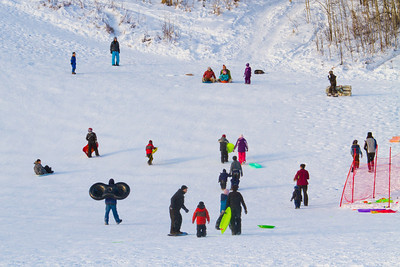 Since Monday, Feb. 20 was a no-school day in the Fairbanks district, the sledding hill on the UAF campus got a lot of use. Mild temperatures and sunshine contributed to the fun.  Filename: LIF-12-3295-05.jpg