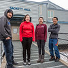 "Sackett Hall residents Evan Wassilie from Kasigluk, Wilona Okitkun from Kotlik, Larissa Flynn from Chefornak and Justin Bill from Tooksook Bay pose in front of the residence hall at UAF's Kuskokwim Campus in Bethel on a chilly March evening.  <div class=""ss-paypal-button"">Filename: LIF-16-4859-509-2.jpg</div><div class=""ss-paypal-button-end""></div>"