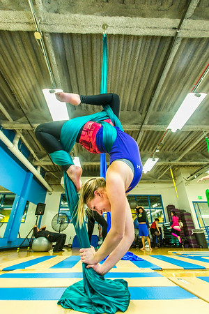 Lindsey Dreese practices a move during a silk club meeting in the SRC. Dreese, a junior biology major, helped start the club which now features about 25 students and staff members who meet twice a week to learn new moves and increase strength and flexibility.  Filename: LIF-13-4025-5.jpg