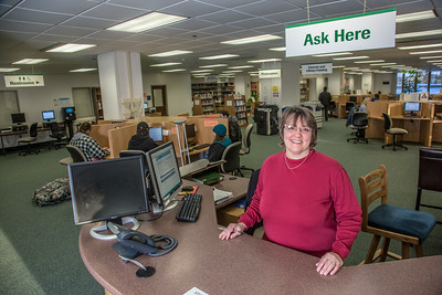 Associate professor of library science Suzan Hahn works the reference desk in the UAF Rasmuson Library on the Fairbanks campus.  Filename: LIF-14-4045-169.jpg