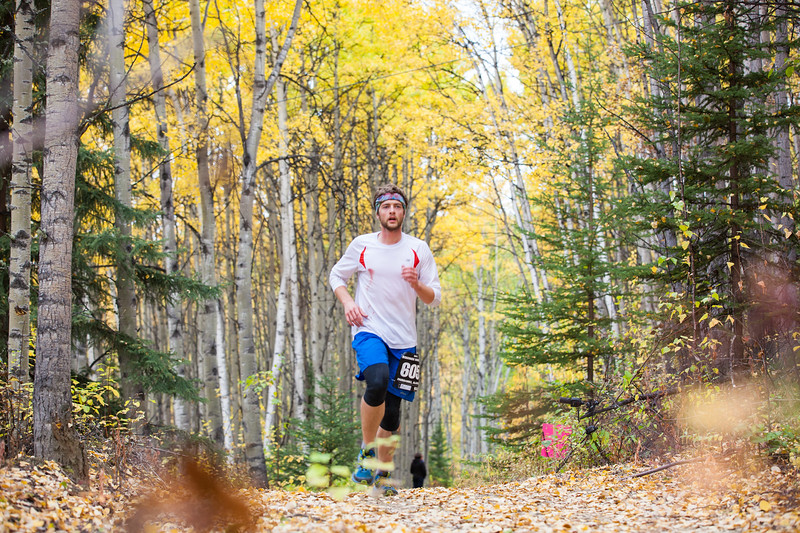 """UAF Student Robin Wood races toward Henderson Road Saturday September 15, 2012 at the 50th Annual Equinox Marathon. Wood placed 102th overall in the men's category.  <div class=""""ss-paypal-button"""">Filename: LIF-12-3553-150.jpg</div><div class=""""ss-paypal-button-end"""" style=""""""""></div>"""