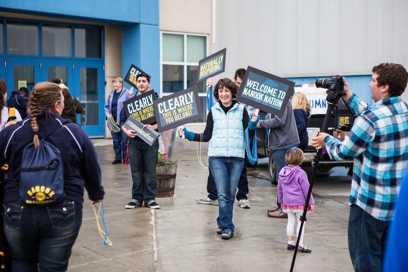 """Holding signs and supportive smiles, UAF Alumni greet incoming students as they walk inside the Student Rec. Center during New Student Orientation.  <div class=""""ss-paypal-button"""">Filename: LIF-13-3924-23.jpg</div><div class=""""ss-paypal-button-end"""" style=""""""""></div>"""