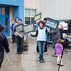 "Holding signs and supportive smiles, UAF Alumni greet incoming students as they walk inside the Student Rec. Center during New Student Orientation.  <div class=""ss-paypal-button"">Filename: LIF-13-3924-23.jpg</div><div class=""ss-paypal-button-end"" style=""""></div>"