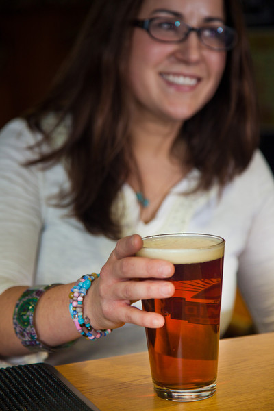 """Senior Kelley Ryan unwinds after a week of classes with a cold beer in UAF's Wood Center Pub.  <div class=""""ss-paypal-button"""">Filename: LIF-11-3217-031.jpg</div><div class=""""ss-paypal-button-end"""" style=""""""""></div>"""