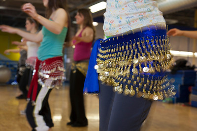 The students of the middle eastern dance class learn how to shimmy in their beaded skirts.  Filename: LIF-11-3194-115.jpg