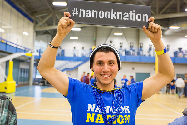 """Christopher Baca holds a Nanook Nation sign during the last event of the New Student Orientation at the Student Rec. Center.  <div class=""""ss-paypal-button"""">Filename: LIF-13-3924-136.jpg</div><div class=""""ss-paypal-button-end"""" style=""""""""></div>"""