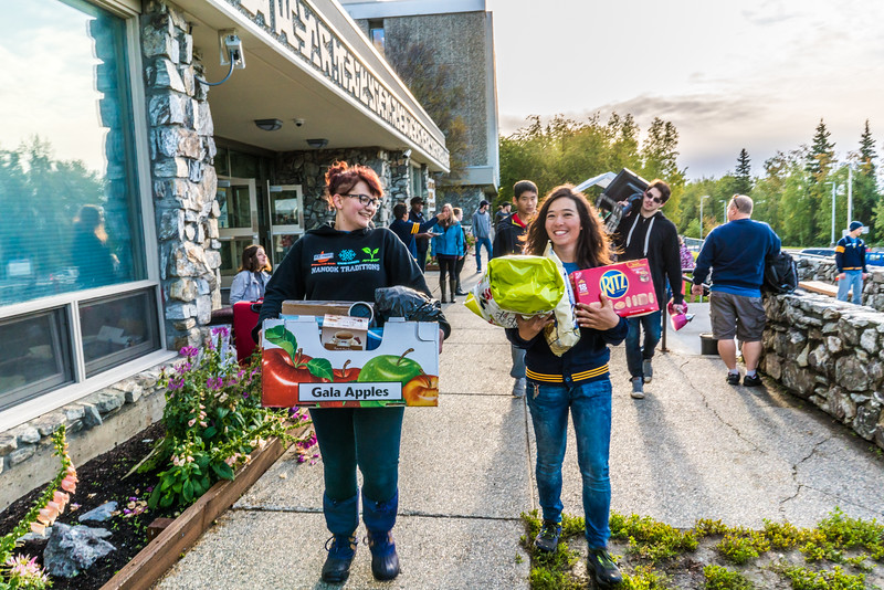 """Returning students, staff and parents all pitch in to help new arrivals move into the residence halls during Rev It Up on the Fairbanks campus at the beginning of the fall 2015 semester.  <div class=""""ss-paypal-button"""">Filename: LIF-15-4637-33.jpg</div><div class=""""ss-paypal-button-end""""></div>"""