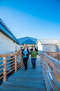 Students Alyssa Wols, left, and Marjorie Tahbone walk between buildings at UAF's Northwest Campus in Nome.  Filename: LIF-16-4865-197.jpg